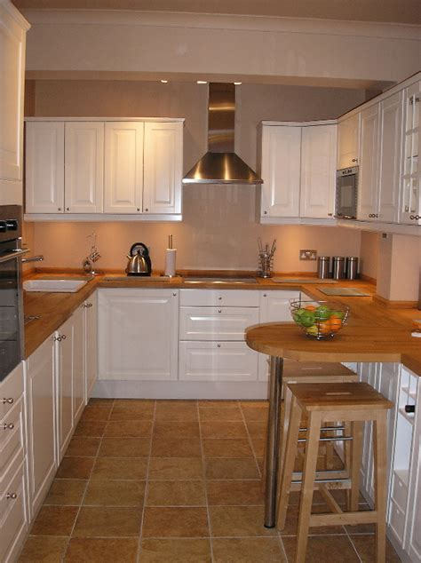 ikea kitchen with customised breakfast bar an carpentry