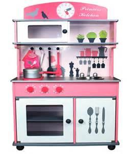 butternut pink wooden kitchen with accessories