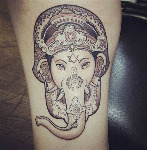 blue geisha tattoo this amazing hamsa ganesh was designed by curtis at