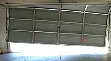 bent garage door track repair call 281 395 5600