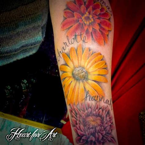 tattoo name with flowers tattoo of birth flowers and names of children body art