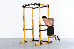 a barbell plus a powertec power rack for a ready
