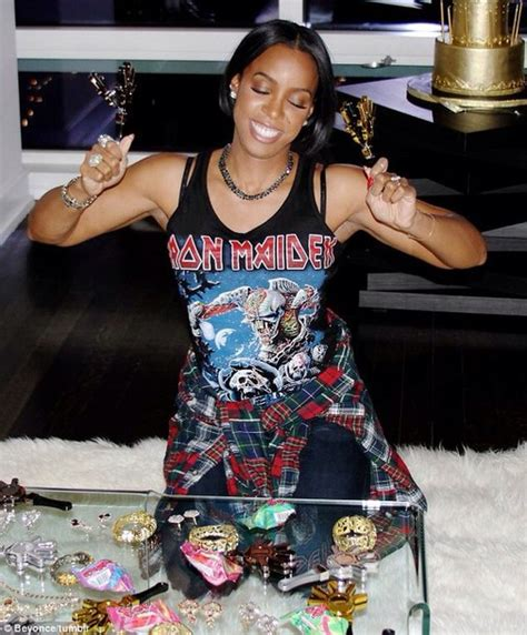 kelly rowland in a white tank top highlighing derriere in tank top kelly rowland beyonce iron maiden rock bands