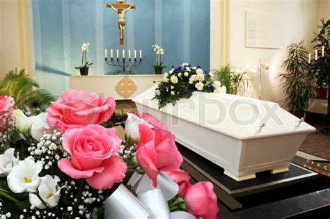 funeral chapel with a white coffin and beautiful roses