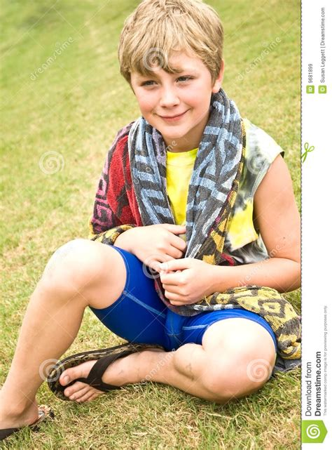 free cute teenage boys images pictures and royalty free cute boy sitting in grass stock image image of expression