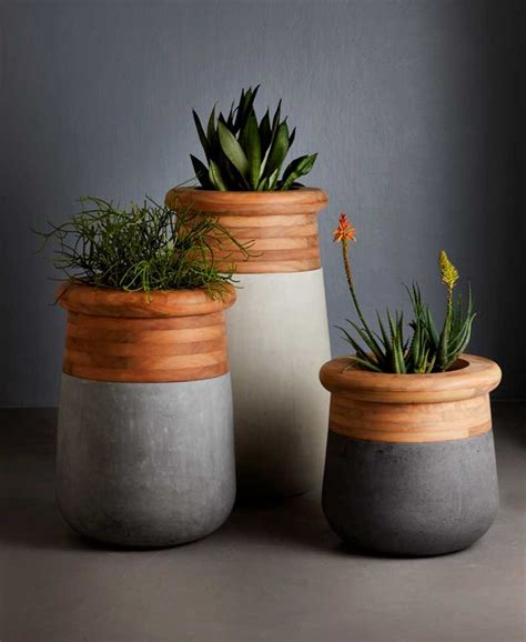 Oversized Planter by Sized Planter That Is Made From Wood And Concrete