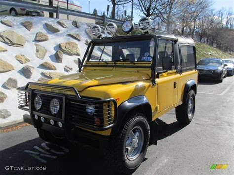 land rover defender 90 yellow aa yellow 1997 land rover defender 90 soft top exterior