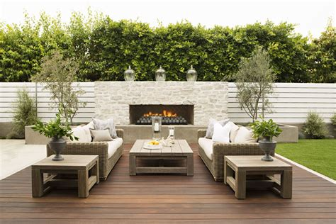 modern patio vertical white fence outdoor fireplace in the wall clean