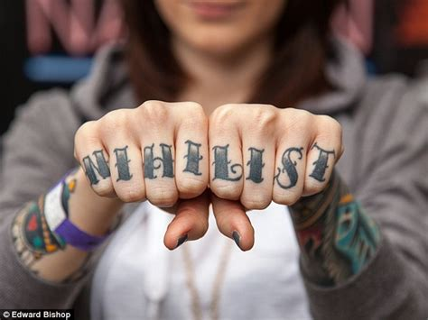 ink fans show off their amusing knuckle tattoos daily