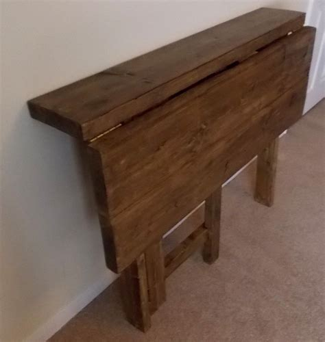 Old and vintage wood wall mounted drop leaf kitchen table with wood folding chairs ideas
