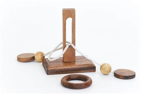 Wood And String - oliver ring wooden string puzzle solve it think out