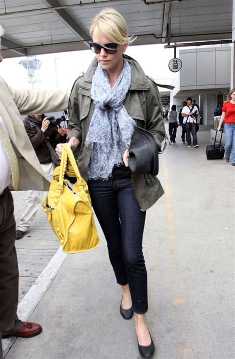 Charlize Theron With And Balenciaga Purses by Charlize Theron Yellow Balenciaga Style Trendy