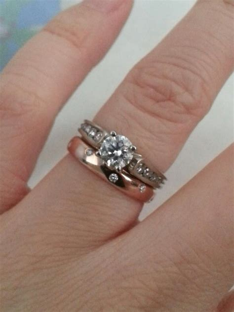 grand white gold engagement ring with yellow gold band