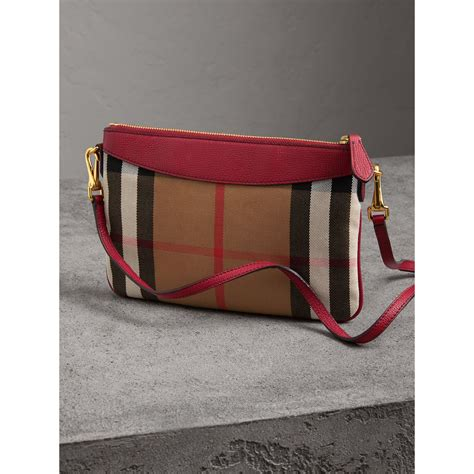 check in bag united house check and leather clutch bag in military red women