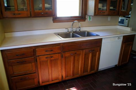 Removing Old Kitchen Faucet by Kitchen Countertop And Sink Installation
