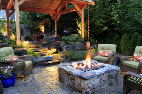 fire in the backyard rustic backyard area with stone fire pit this cozy