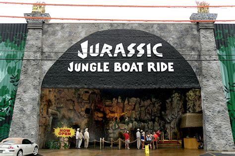 microblog point fake people standing outside milling - Jurassic Jungle Boat Ride In Pigeon Forge Tennessee