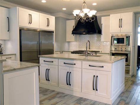 white shaker kitchen cabinets  glass doors