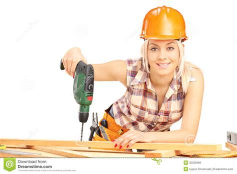 Female carpenter with helmet at work using hand drilling machine stock photo image 32035968