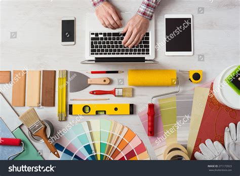 professional decorators professional decorators hands working his desk stock photo