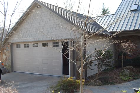 walk thru custom garage door residential walk through garage door installation repair
