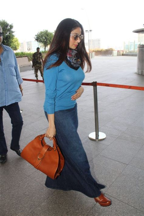 sridevi with her husband photos sridevi spotted with her husband at airport
