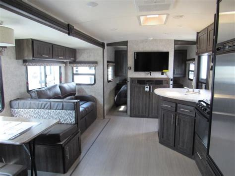 ultra light travel trailers with outdoor kitchens 2018 open range ultra lite 2604rb rear bath with outdoor