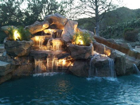 swimming pools with rock waterfalls pictures pixelmari com swimming pool rock waterfalls backyard design ideas