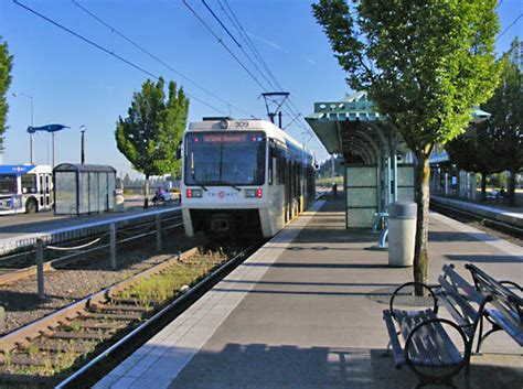 Light Rail To Airport by Three Tracks At Cascades