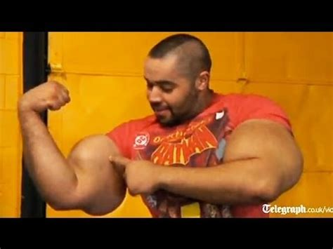 worlds biggest biceps bodybuilder sets record for world s biggest arms youtube