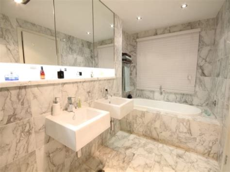 modern bathroom design with recessed bath using marble bathroom photo 365435