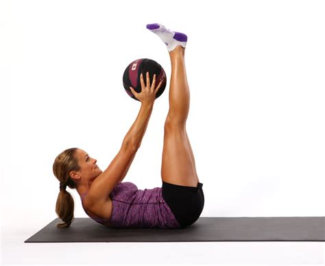 double crunch pulse running  dumbbell workout popsugar fitness photo