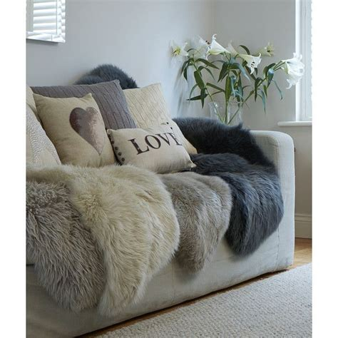 sheepskin rug on sofa 75 best images about sofas on grey velvet and living rooms