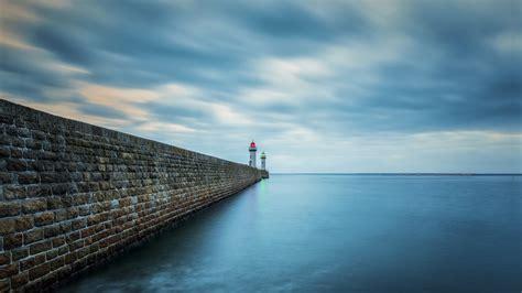 ocean shore pier lighthouse skyline preview wallpapercom