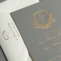 vera wang engraved gold bordered light grey invitation with wildflowers duogram