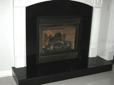 Black Fireplace Surround by Black Marble Fireplace Surround Home Designs Project
