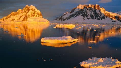 coastal landscape lit   midnight sun antarctic