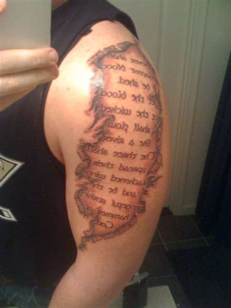 torn ripped skin script tattoo on forearm real photo