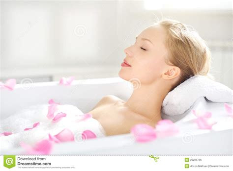 girl on girl in bathroom an attractive girl relaxing in bath stock photo image