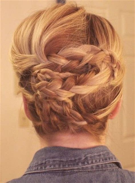 put your hair in a bun with braids four braids wrapped a cute way to put your hair up for