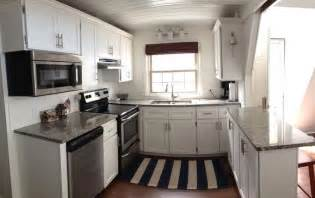 White shaker kitchen cabinets stainless appliances gray granite