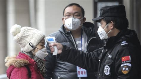 china bans travel  city  center  coronavirus