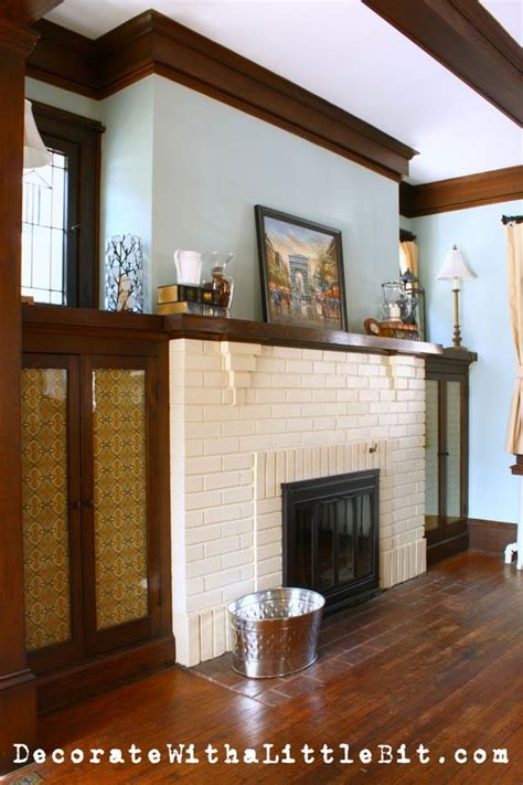 wood trim around fireplace white brick black doors and medium wood trim