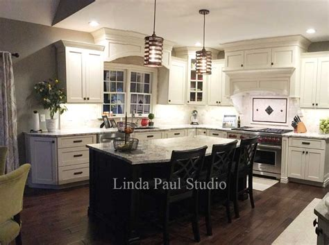 kitchen with white cabinets backsplash and bronze accents kitchen backsplash ideas pictures and installations
