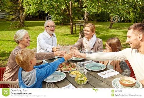 family in the garden happy family dinner in summer garden stock photo