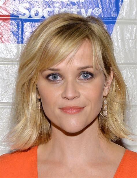 hollywood mid length hairstyles reese witherspoon medium wavy cut with bangs shoulder