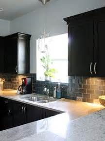 black glass backsplash kitchen 1000 images about kitchen renovation on pinterest dark cabinets light granite and glass