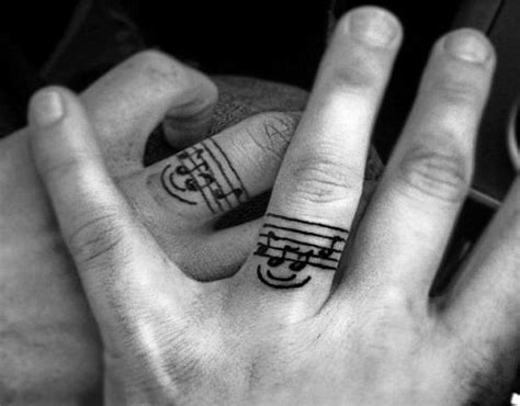 couples music tattoos instead of wedding rings