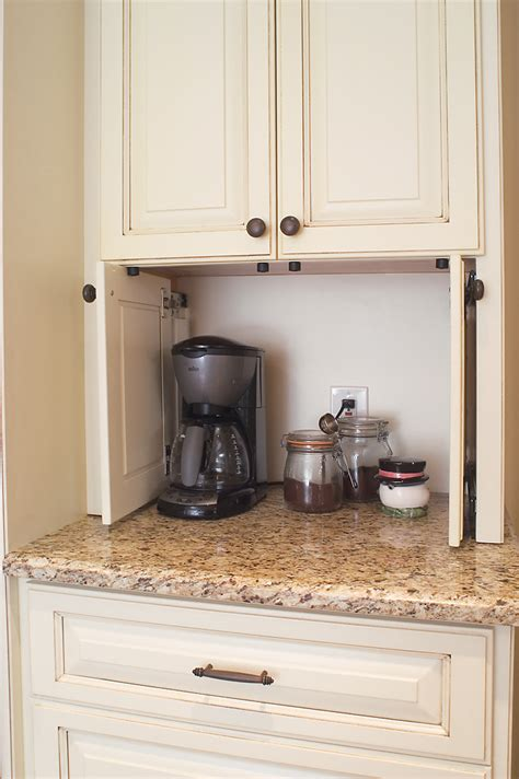 kitchen appliance cabinets pocket doors to hide kitchen appliances a must in a dream