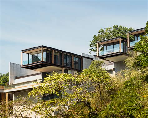 designboom resort matchbox villas protrude from thai mountainside at naka